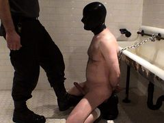 Kneeling on the wetroom floor, mostly naked except for boots mature gay fuck
