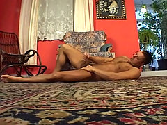 Handsome guy lay down on the floor to play with his cock