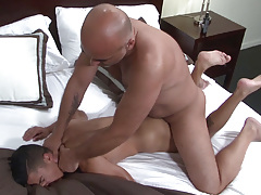 Big dicked Daddy Brian is ecstatic when he spies sexy sub boy Armond Rizzo in the bed. Armond has no trouble in wrapping his lips around Brian's fat cock and then happily stretches his cheeks so that Brian can pound his tough cock deep inside his ass. B