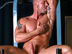 Mitch tugs on his cock, buck naked on his workout machine mature gay fuck