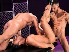 Naked except for their ebony leather boots, three horny men indulge their primal urges. Hairy bodybuilder Bruce Beckham and tatted FX Rjos stand over smooth Josh Conners, who is crouching with his spread waste cheeks in the air. Bruce and FX take turns ri mature gay fuck