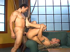 Hot stud fucks his houseboy in his living room in here